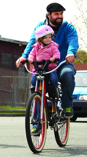 Family on bike by Christopher Cotrell on Flickr